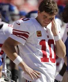 Giants quarterback Eli Manning stands on the sideline