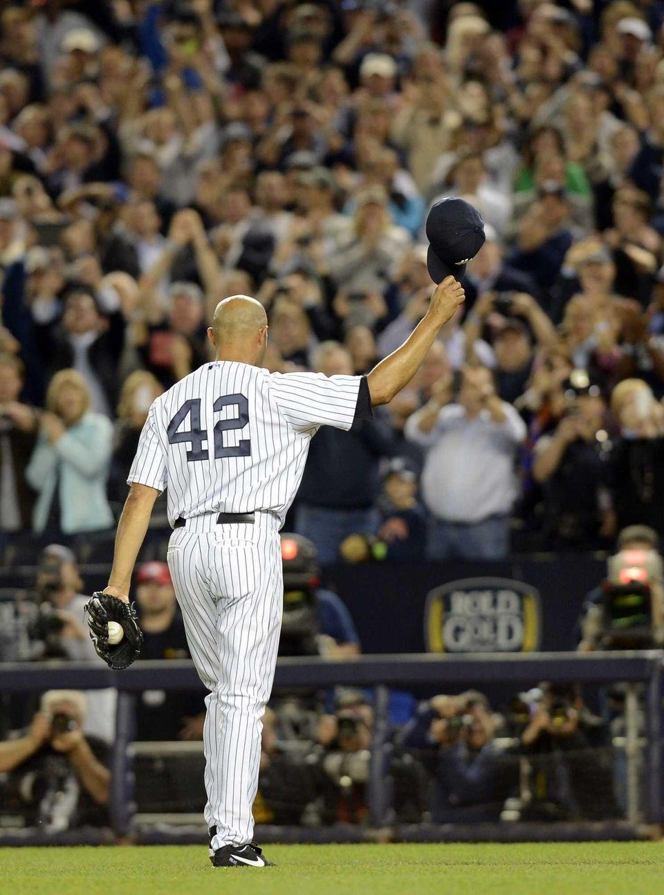New York Yankees pitcher Mariano Rivera tips his