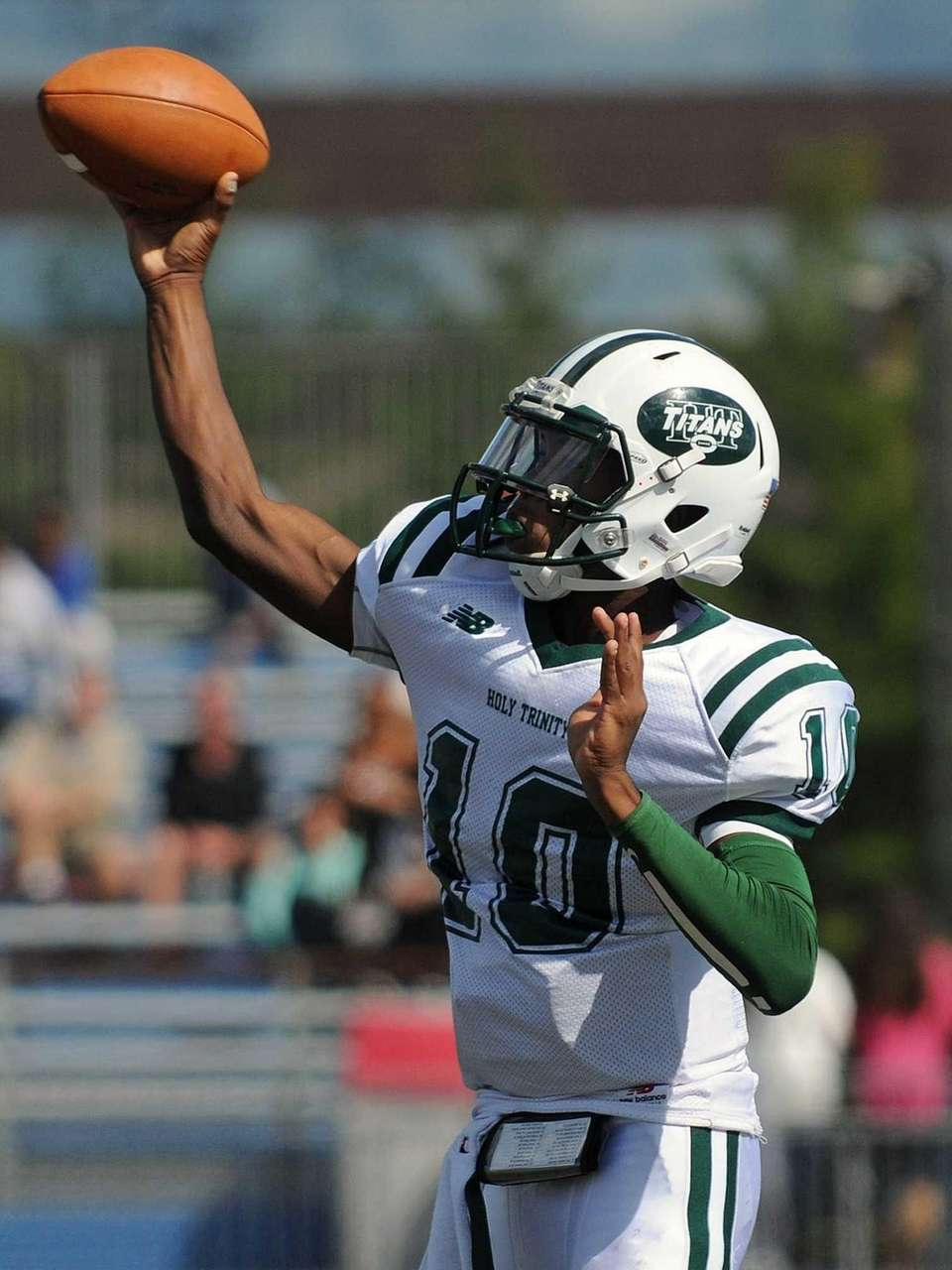 Holy Trinity quarterback Cameren Hayes throws a pass