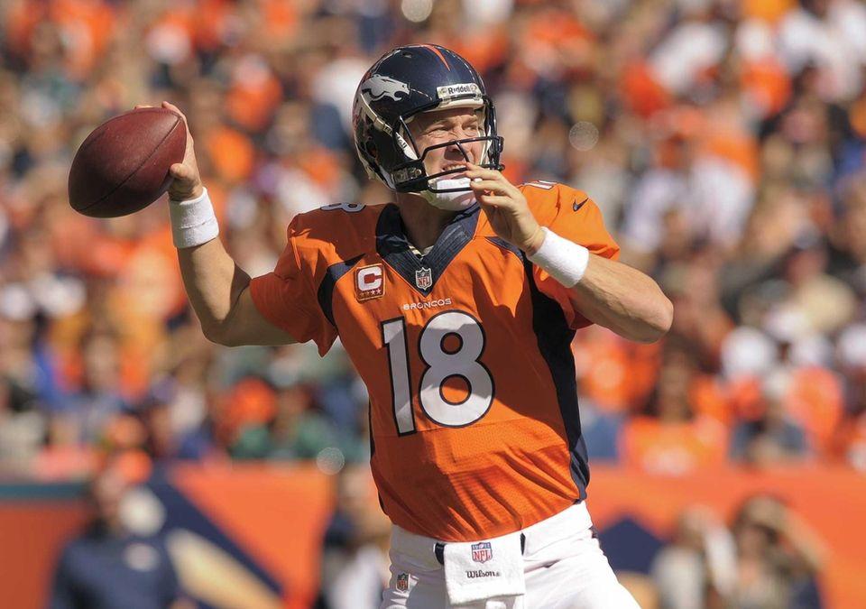 Denver Broncos quarterback Peyton Manning (18) passes the