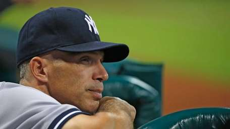 Yankees manager Joe Girardi watches from the dugout