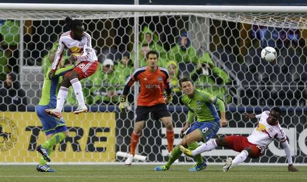 Seattle Sounders goalkeeper Michael Gspurning, center, watches as