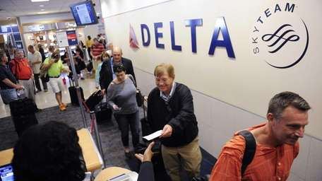 Delta Air Lines passengers, who have purchased an