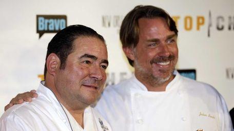 Chefs Emeril Lagasse, left, and John Besh arrive