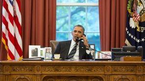 President Barack Obama speaks with President Hassan Rouhani