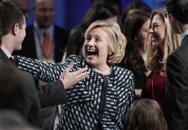 Former Secretary of State Hillary Rodham Clinton greets