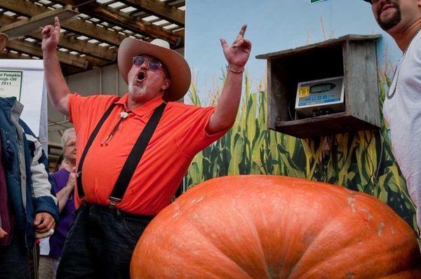 George Davis, of Ronkonkoma, celebrates his pumpkin, which