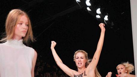 Topless Femen activists disrupt the Nina Ricci show