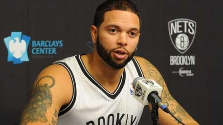 Nets point guard Deron Williams speaks to reporters