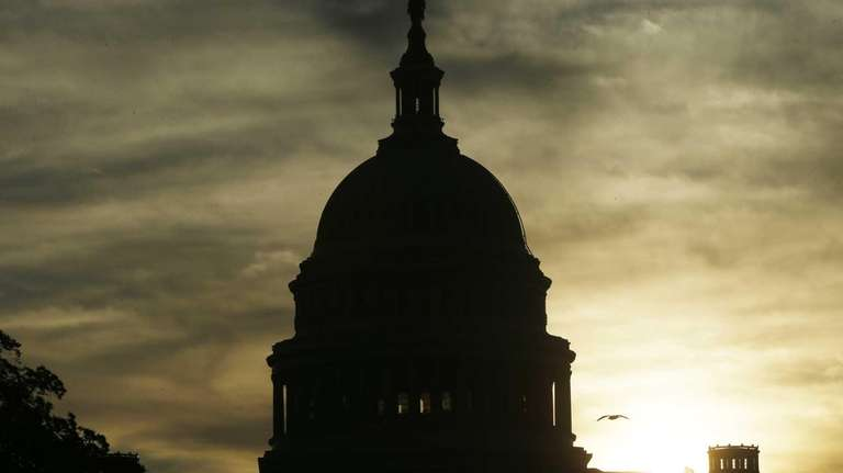 The sun rises over the U.S. Capitol. (Sept.
