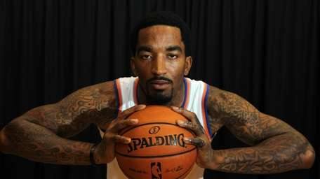 J.R. Smith poses during Knicks media day in