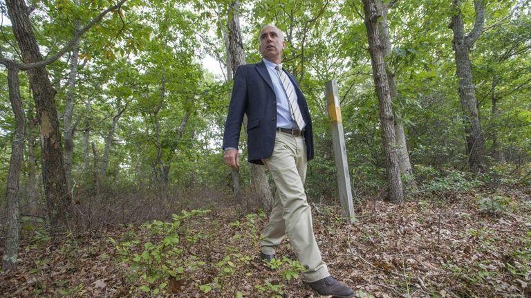 Suffolk County legislator Jay Schneiderman walks by a
