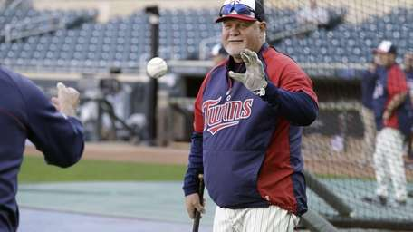 Minnesota Twins manager Ron Gardenhire hits grounders to