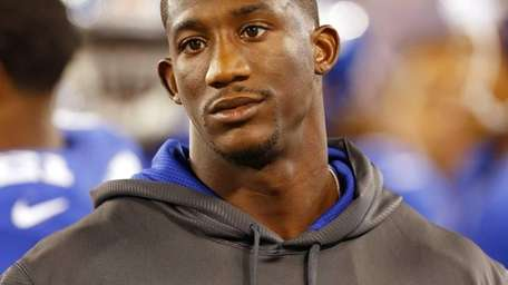 Antrel Rolle looks on during a preseaosn game