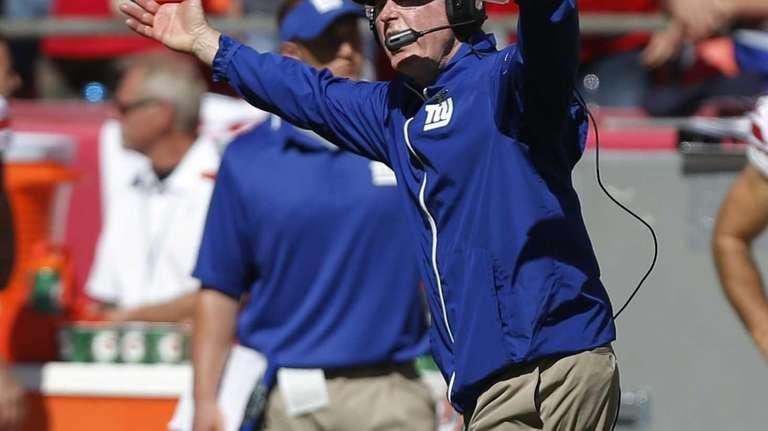 Tom Coughlin yells to a game official during