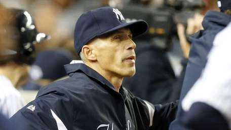 Joe Girardi looks on from the dugout during