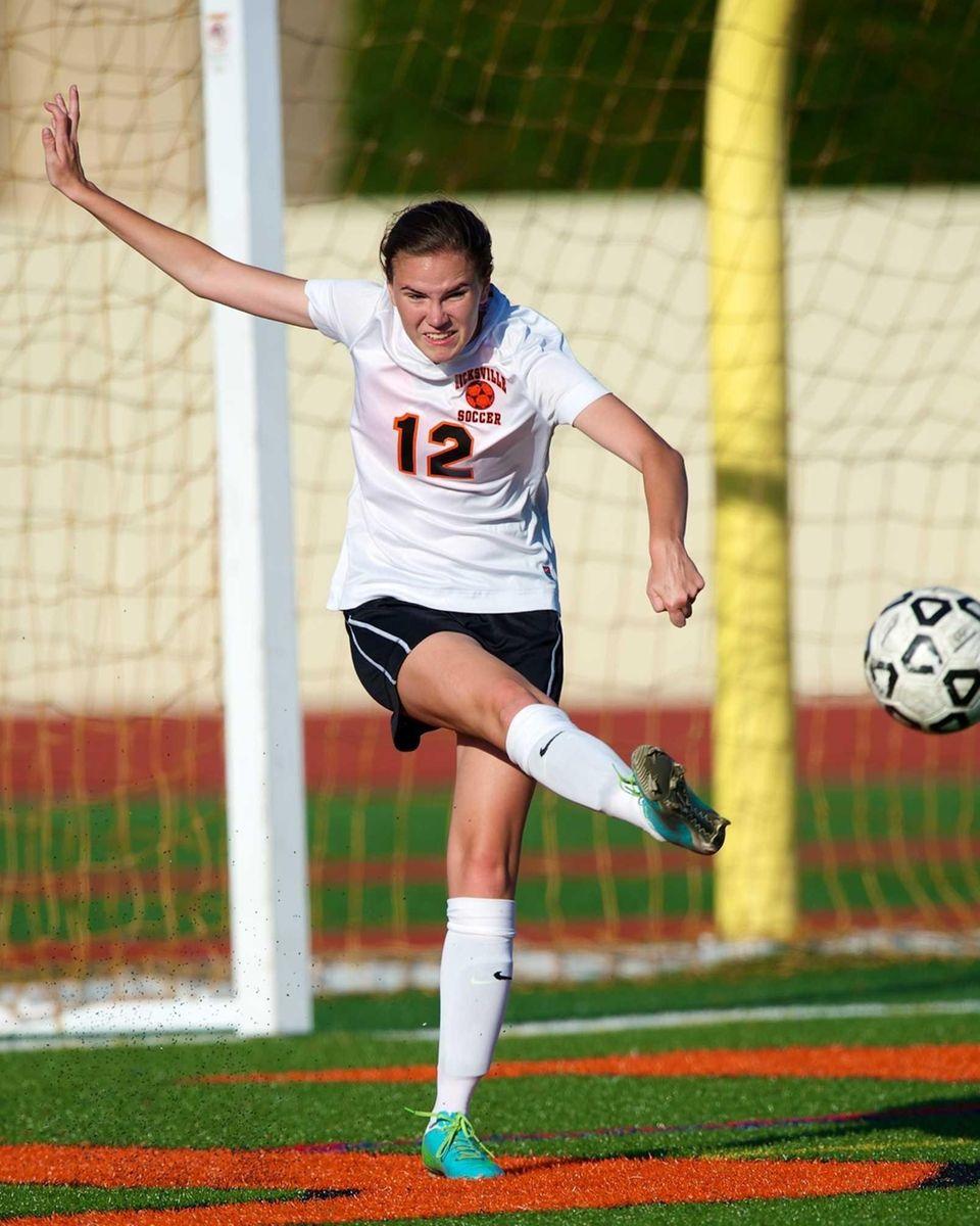 Hicksville's Kelly Carroll (12) clears the ball down