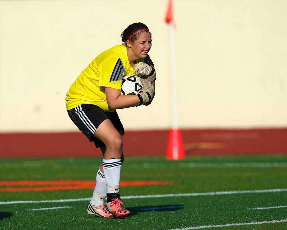 Hicksville goaltender Alexa Higgins (29) controls the ball
