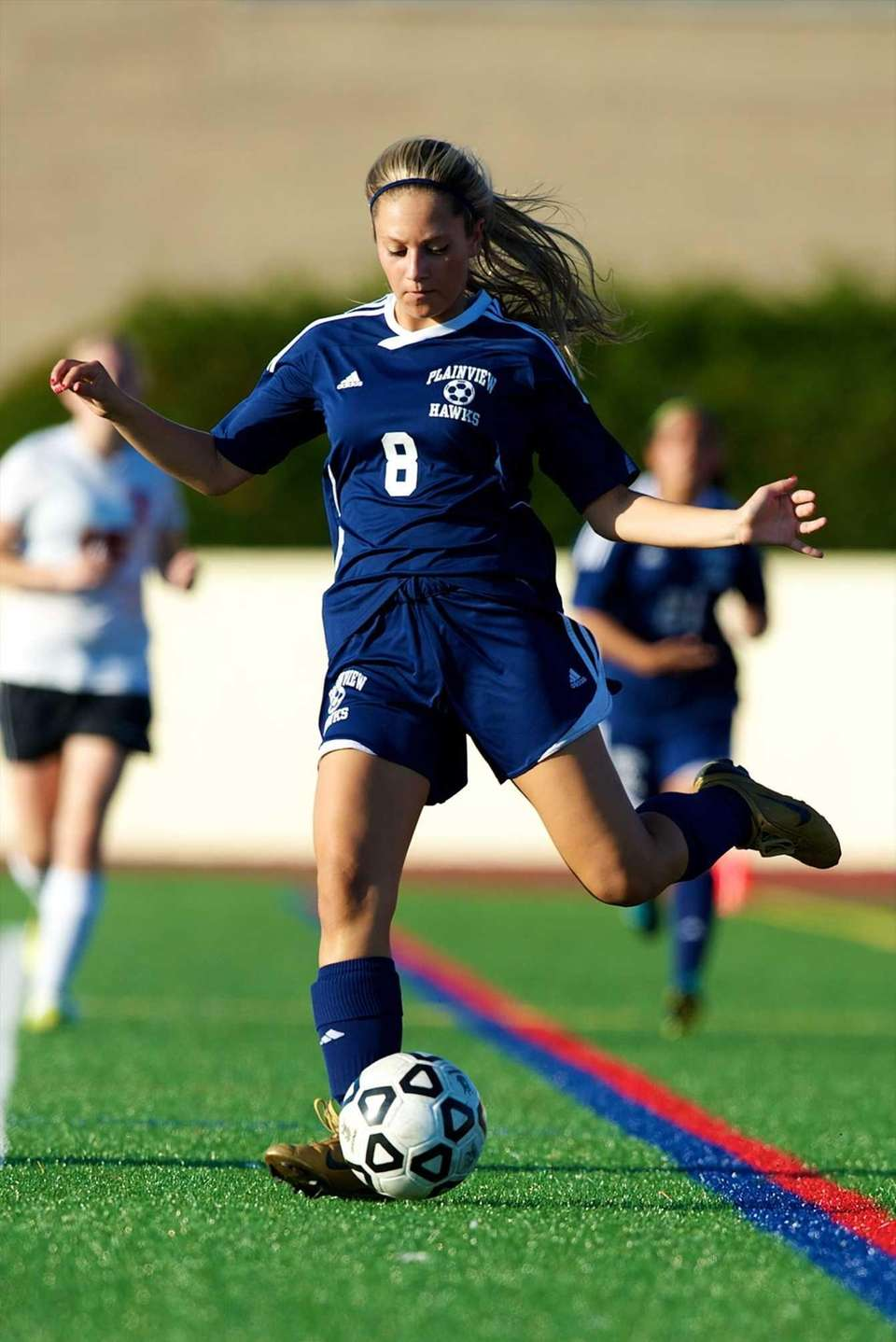 Plainview JFK's Joanna Karp (8) passes the ball