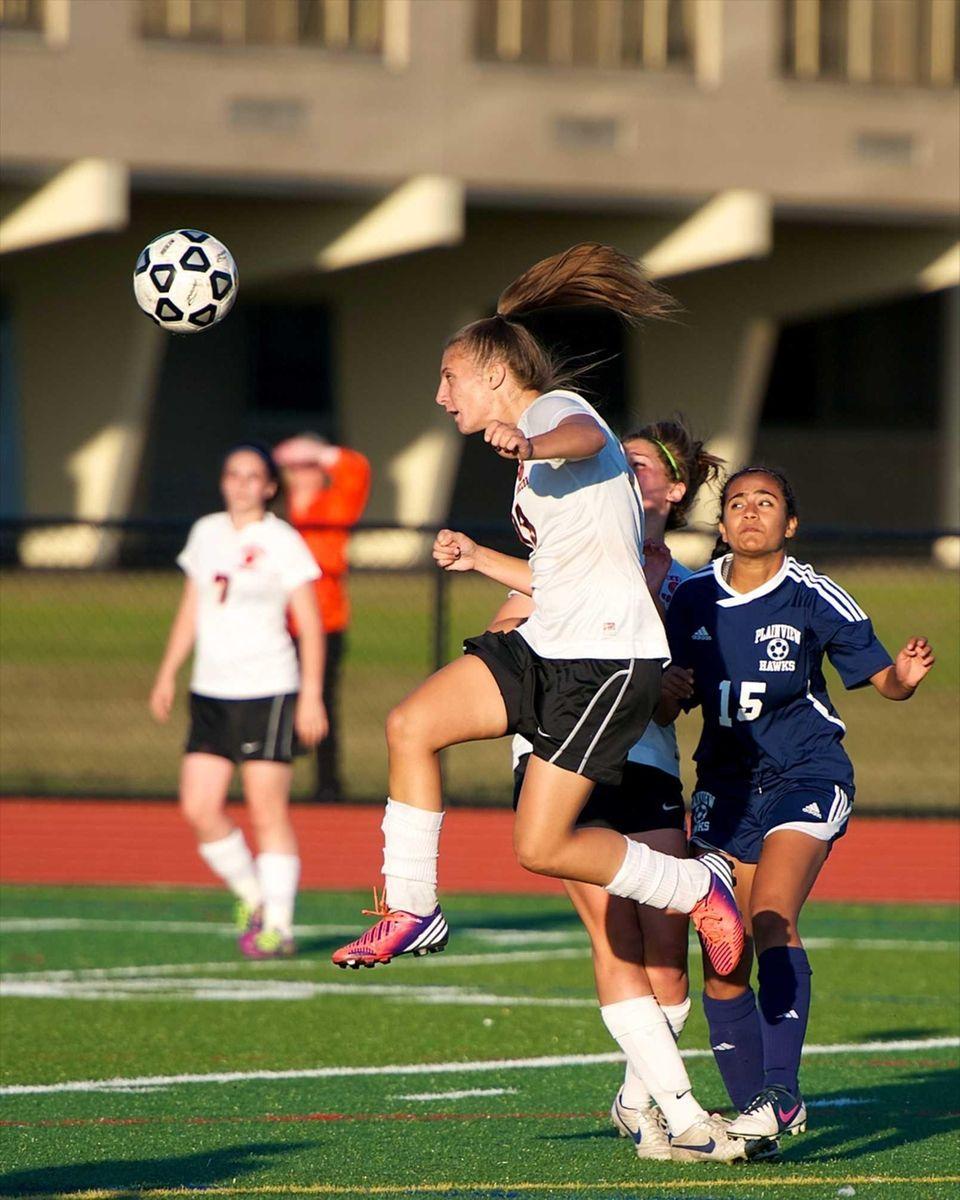 Hicksville's Keley Abbriano (13) clears the ball away
