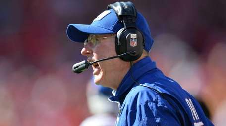 Tom Coughlin reacts to a call during the