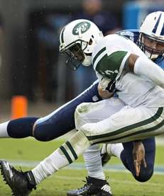 The Tennessee Titans' Karl Klug strips the ball