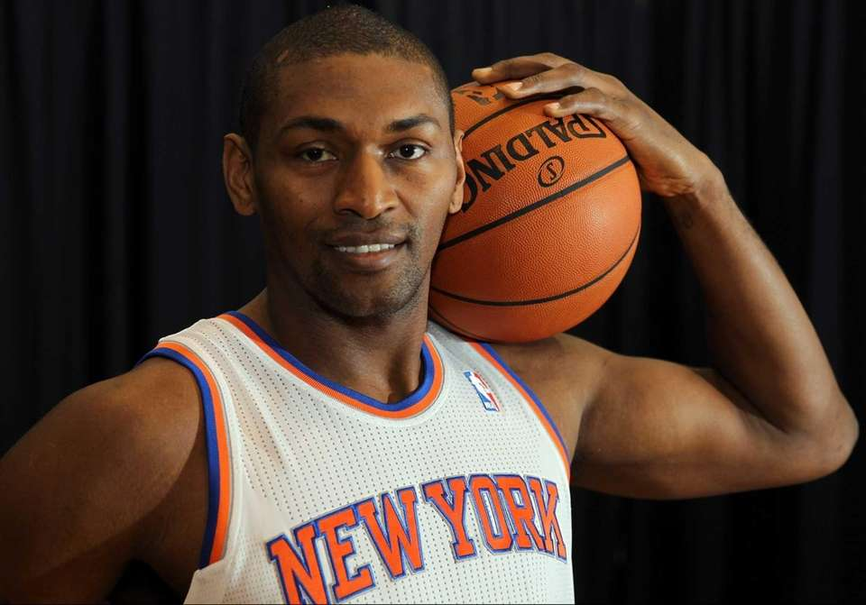 Metta World Peace poses for a photo at
