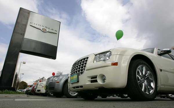 Chrysler cars are displayed at a Chrysler dealership