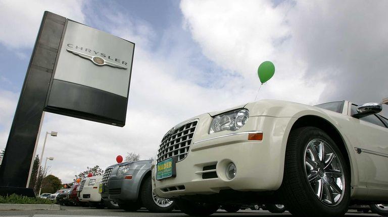 Chrysler cars are displayed at a Chrysler dealership