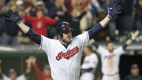 Jason Giambi of the Cleveland Indians celebrates after
