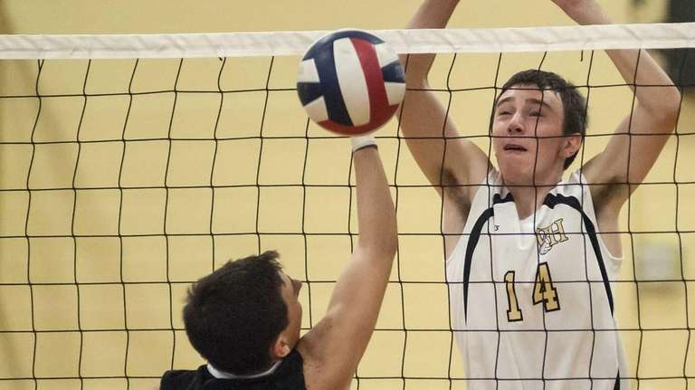 Bellmore JFK's Andrew Sheehan, left, can't stop the
