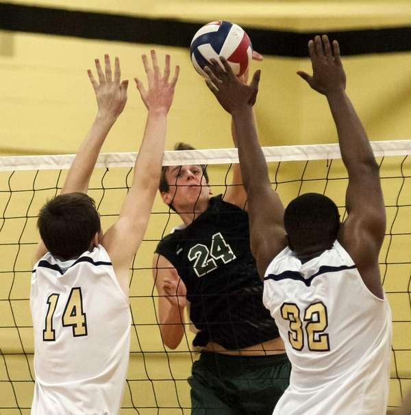 Bellmore-JFK's Gary Anderson, center, spikes the ball past