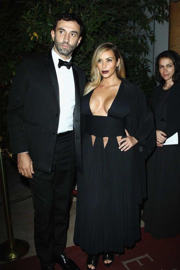Givenchy designer Riccardo Tisci and Kim Kardashian attend