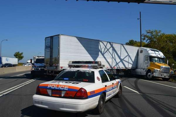 A tractor-trailer jackknifed on the Long Island Expressway