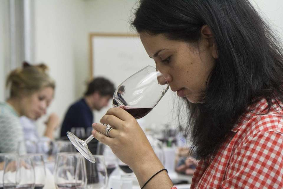 A participant in the International Wine Center's WSET