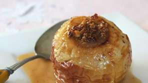 Baked apples are filled with maple syrup, walnuts,