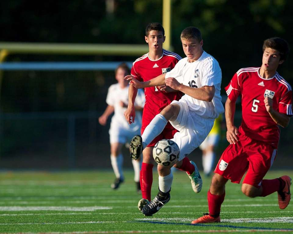 Smithtown West midfielder Austin Thiele gains possession of