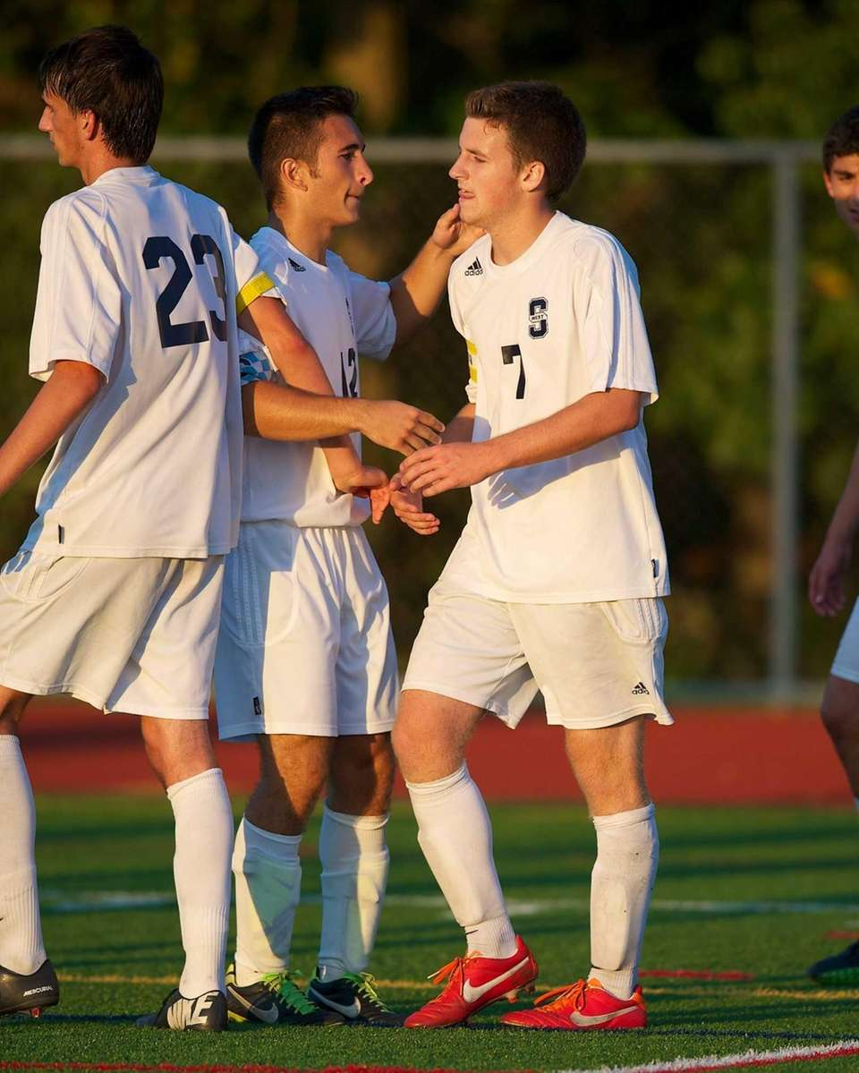 Smithtown West midfielder/defender Garrett Sweeney, right, is congratulated