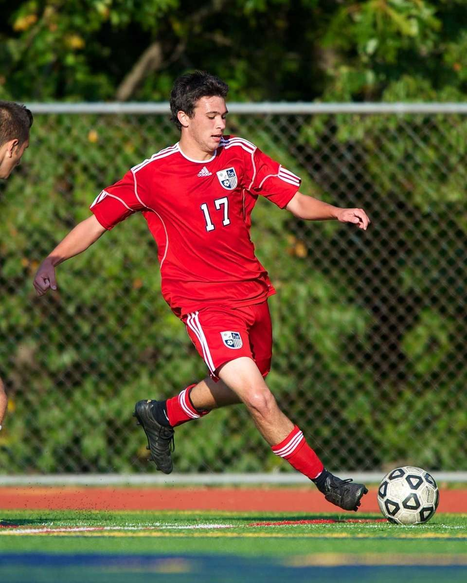 Smithtown East forward David Robinson takes a shot