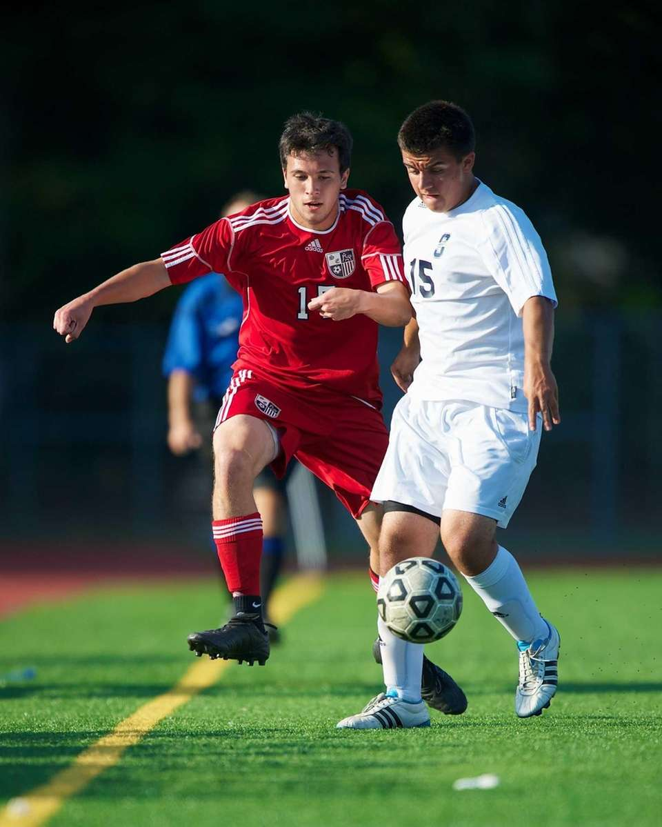 Smithtown West midfielder/defender Alex DiSalvo battles for possession