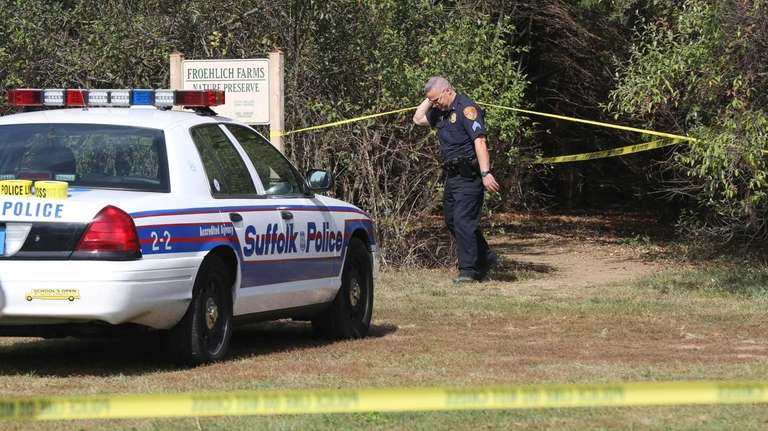Suffolk County police investigate the scene at Froehlich