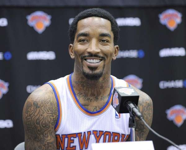 J.R. Smith talks to the media at the