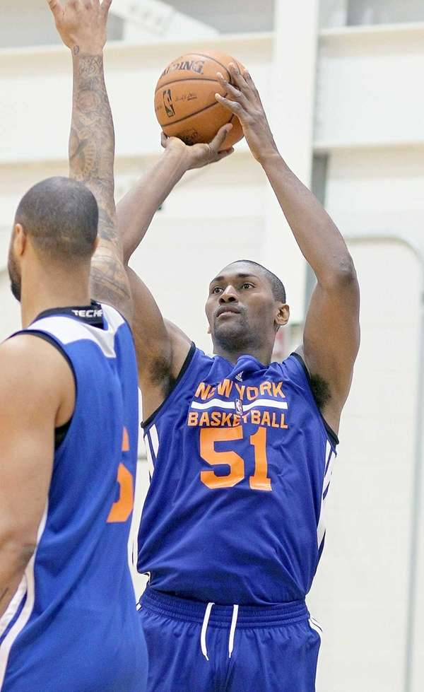 Metta World Peace shoots during practice at the