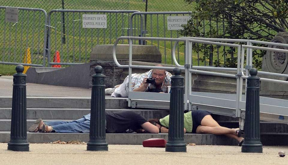 People take cover as gunshots were fired at