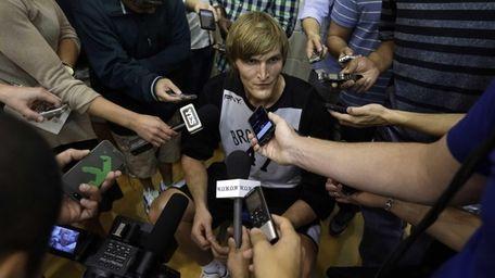 Nets' Andrei Kirilenko speaks with the media during