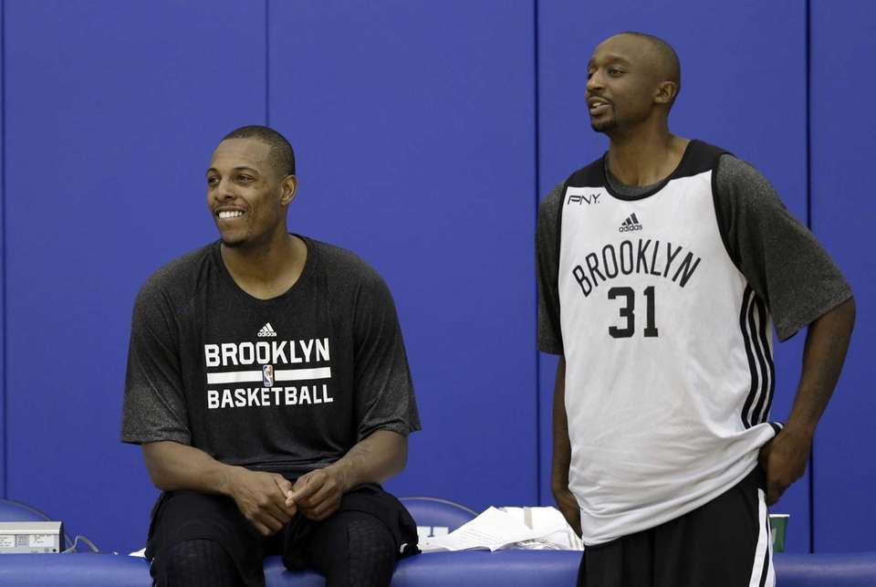 Nets' Paul Pierce, left, and Jason Terry watch