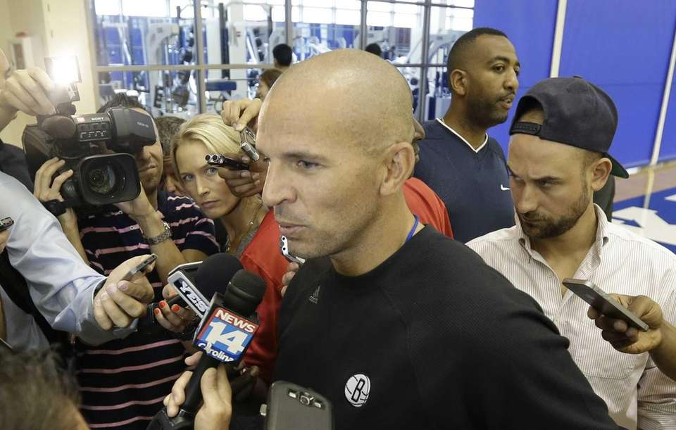 Nets coach Jason Kidd speaks with members of