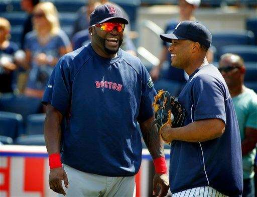 Boston Red Sox designated hitter David Ortiz, left,