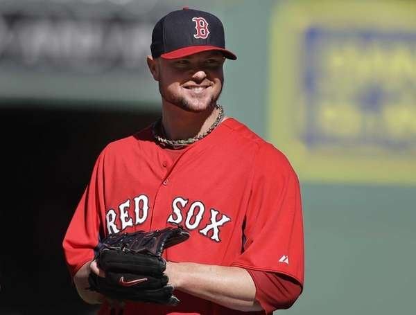 Boston Red Sox pitcher Jon Lester smiles during
