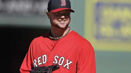Boston Red Sox pitcher Jon Lester smiles during